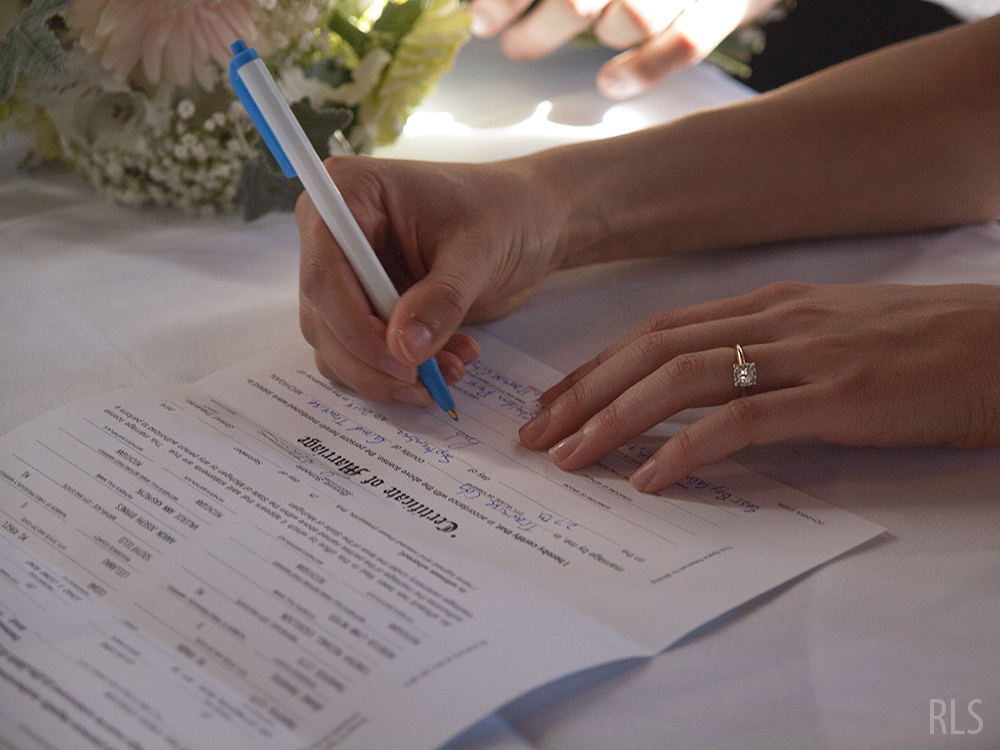 Rachel Esckelson marriage license signing photo Northern Michigan wedding Randi Lyn Stoltz photography Leelanau County wedding barn wedding