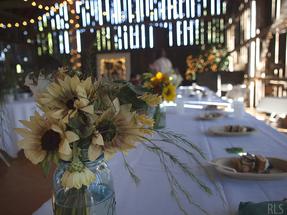 Maggie Lonero flowers sunflowers wedding sunflower arrangement Northern Michigan wedding Randi Lyn Stoltz photography Leelanau County wedding barn wedding