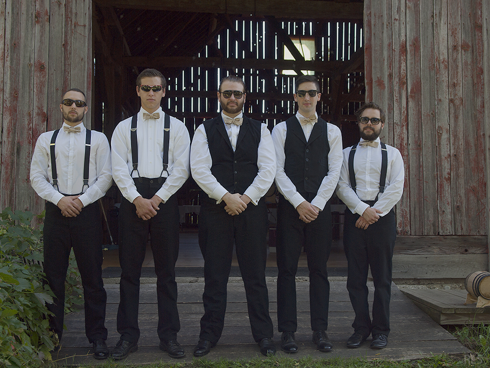 Nicholas Paul John Leach suit and tie groomsmen getting ready photo barn wedding Northern Michigan wedding Leelanau County wedding Randi Stoltz photography
