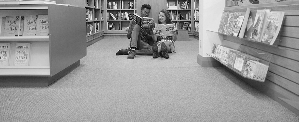 Horizon Books downtown Traverse City engagement photos Nora Seilheimer Joe Northern Michigan wedding photographer black and white engagement photo Aubrey Ann Parker Photography